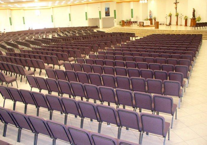 Dark church chairs - in a room