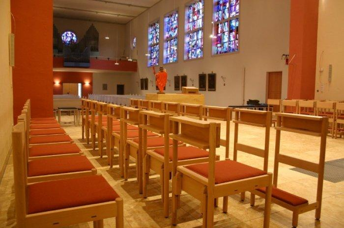 Red church chairs - in a row