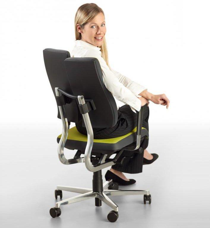 Woman spinning on office chair
