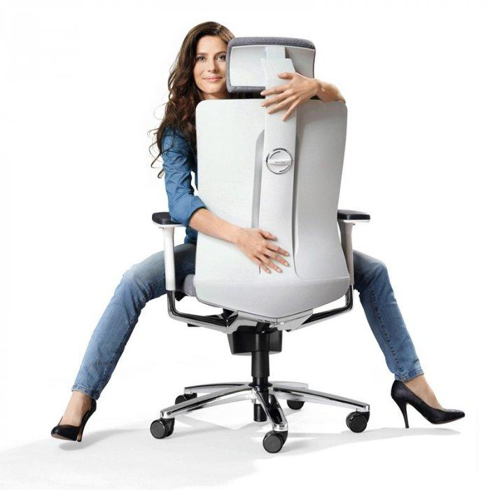 Woman sitting on large office chair