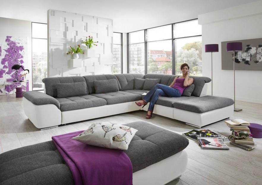 Stylish corner sofa - and woman on it
