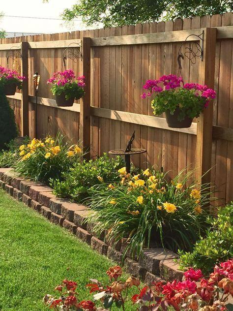 Line Your Fence – Hanging Pots from the Fence