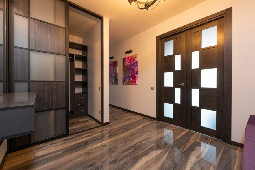 Modern room interior with wardrobe on laminate at home